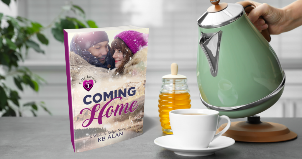 Paperback of Coming Home on counter next to teacup, honey and person pouring from electric kettle